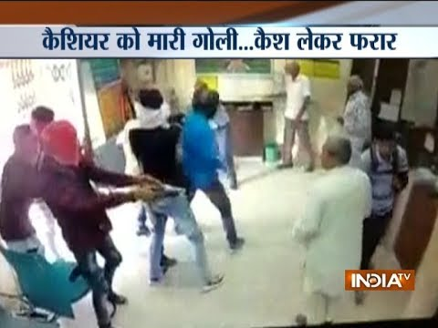 CCTV: Armed robbers kill cashier, loot cash from Corporation Bank in Delhi