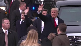 President Trump and family walk toward White House in inaugural parade