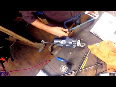 Installing a power trim tilt unit in an outboard motor
