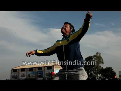 Punjabi man lifts a massive load with his ear