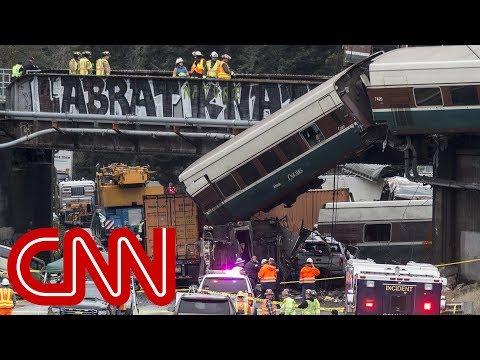 Derailed Amtrak train dangles over highway in Washington