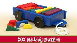 Pull-cart full of building blocks. Classic wooden toy for toddlers. Free plans.
