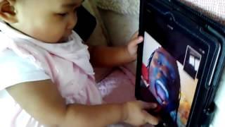Baby Yuri sharing cherries with her daddy