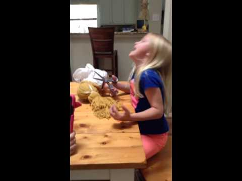 7 year old murdering doll while giving it a haircut