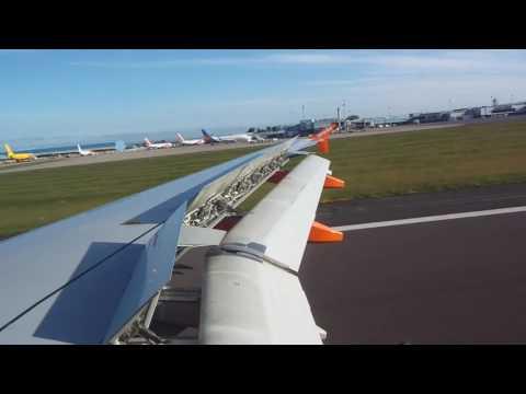 easyJet Airbus A319 landing in Belfast International runway 25 from Liverpool