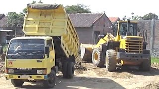 Dump Trucks Unloading Dirt Wheel Loader Komatsu WA350 Pushing Moving It