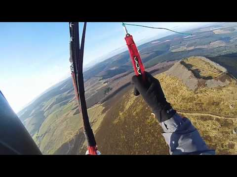 Paragliding over the top of the Hill Fort on the Tap O Noth, Rhynie, Aberdeenshire, Scotland.