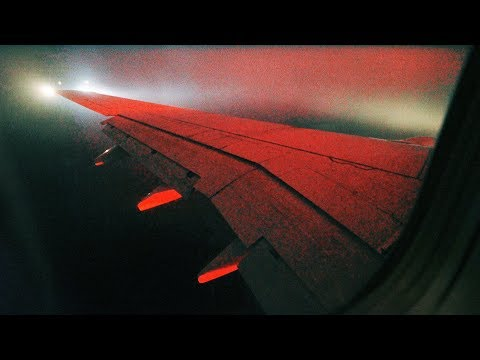 Piercing Clouds at Night - SAS Boeing 737-600 Landing in Copenhagen Airport