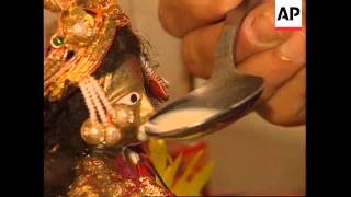 HONG KONG HINDU MIRACLE MILK OFFERING TO STATUES IN TEMPLE