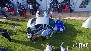 Groom surprises bride with BMW on their wedding day