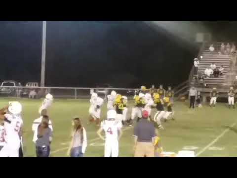 Caleb Nolan scoring a touch down for crest high school