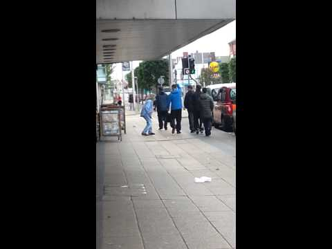Drunk guy falling over in bootle