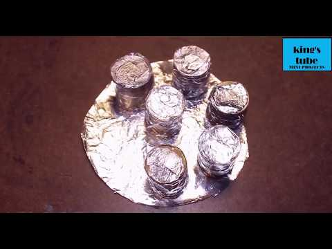 Charge your mobile phone using coins!!Free energy mobile charger it's amazing