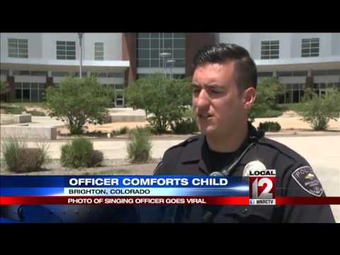 Police officer soothes toddler after deadly crash