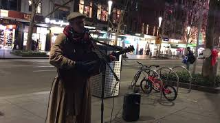 Street musician in the city of Melbourne, a voice that touch my soul