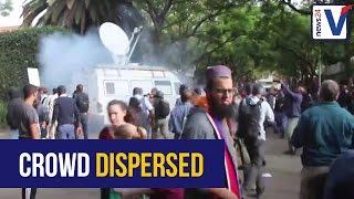 WATCH: Police fire stun grenade on crowds outside Gupta home