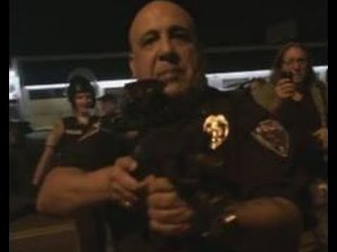 Caught on Camera: Cop Points Rifle at Ferguson Protesters, Threatens to Kill Them