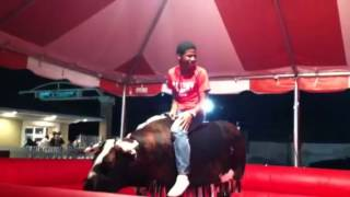 SeQuan bull riding at the PC Fair.