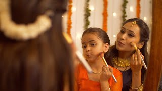 South Indian woman in traditional wear helping her daughter to get ready for the celebration of Diwali - lifestyle Family