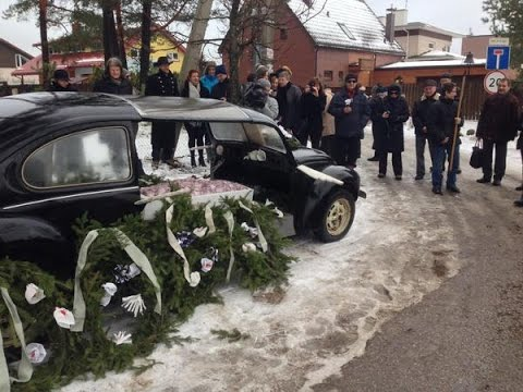 Lithuania: Watch Lithuanians hold FUNERAL over the nation joining Eurozone