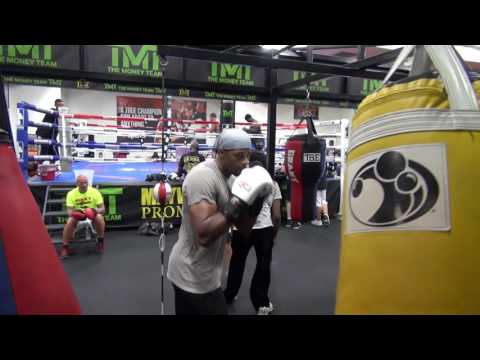 Former NBA star Kendall Gill hitting the bag at the Mayweather Boxing Club