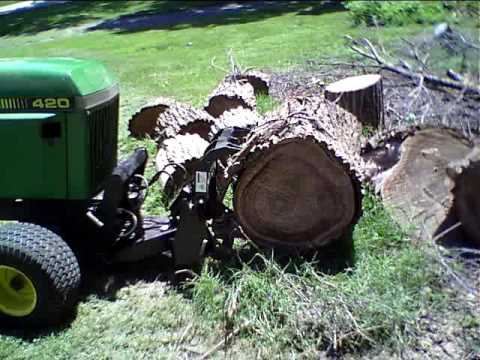 John Deere 420 With Grapple By Innovative Tractor Attachments Youtube