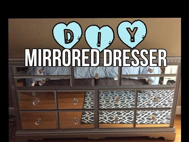 a mirrored dresser