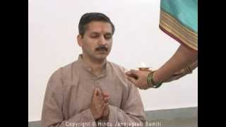 Science behind performing Arti of the person during aukshan ?