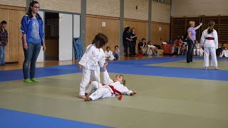Two Little cute girls playing Judo and fighting against each other .. Funny way how to fight