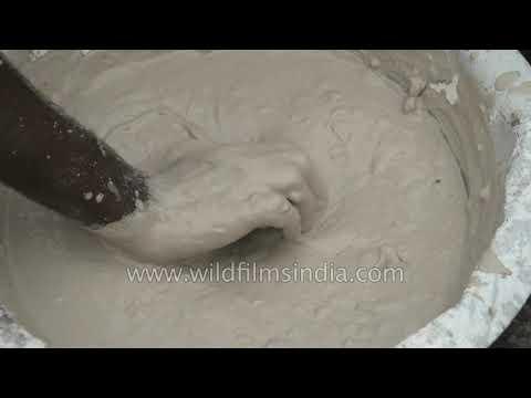 Ganesha idol making, artisan prepares a mixture of PoP