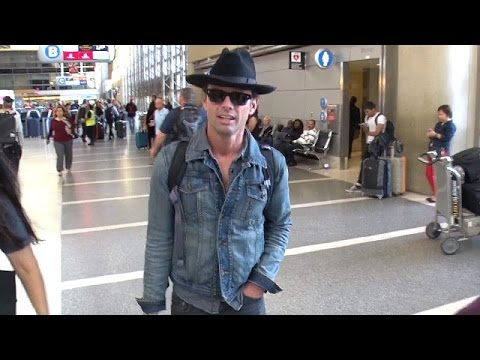 Walton Goggins Wears A Lid At LAX