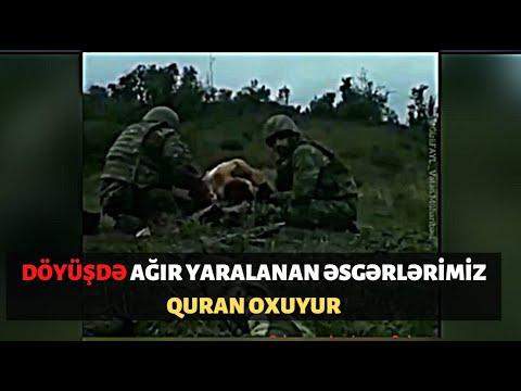 Döyüş meydanında çoxusu yaralanıb. Yaralı əsgər Quran oxuyur. Müharibədən ürək ağrıdan görüntü