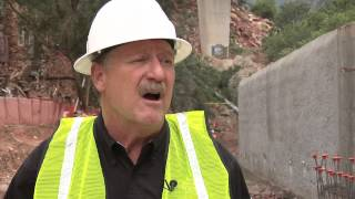Senator Mark Udall surveys the flood recovery efforts in Manitou Springs