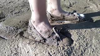 Chinese girl stuck in mud with cute sneakers