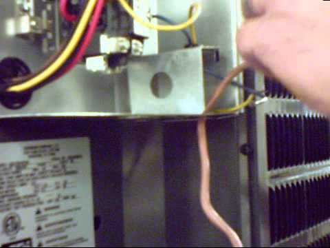 Installing low voltage wire on an air conditioner on