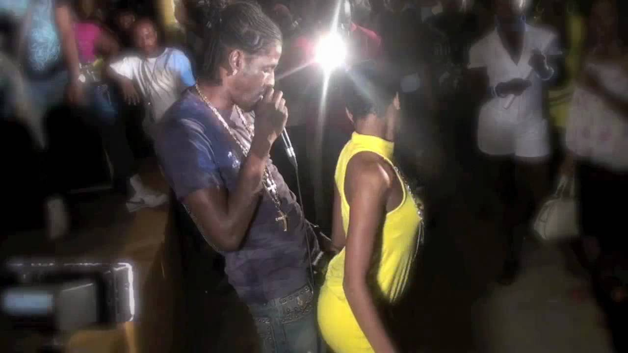 Aidonia performing (daggering) with a female fan at UWI ...