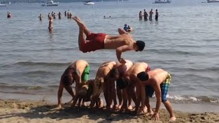 People are Awesome: Frontflip over 6 people at the beach!