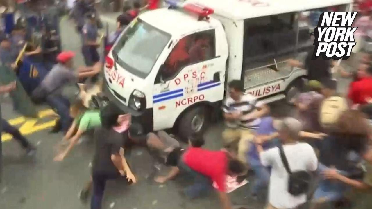 Horrific footage shows Philippines police van driving directly through a crowd of protesters