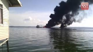 Two wooden boats catch fire