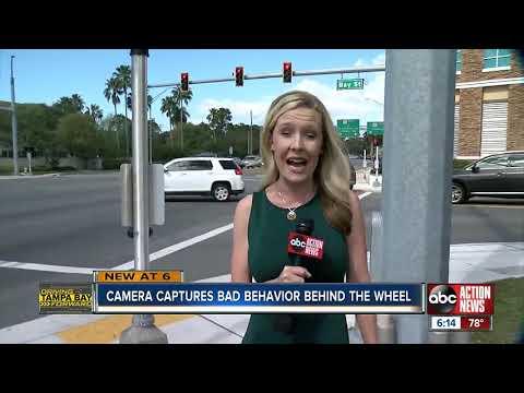Dash Cam Captures Minivan Creeping Through Intersection, Running Red Light