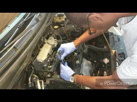 2006 KIA Rio LX with over 464,000 miles removing spark plugs