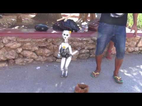 very funny puppet dancing to hot music, incredibly cool