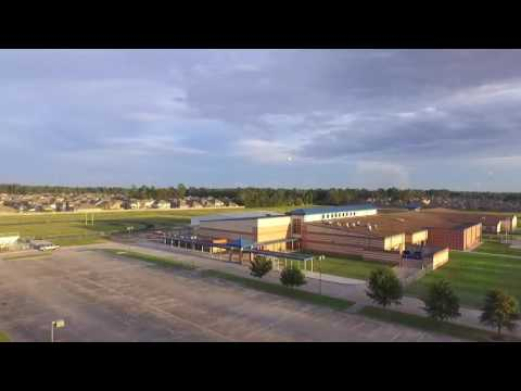 Parachutes falling from the sky. Drone view with chutes