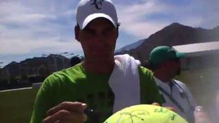 Roger Federer giving autographs at the Indian Wells Open 2011