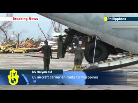 Typhoon Haiyan Aid Arrives: US planes transport heavy machinery and supplies to Tacloban