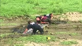 Muddy Rescue for Man and His Parrot