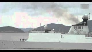 中国海军054A型导弹护卫舰沿着群山雄纠纠气昂昂的航行