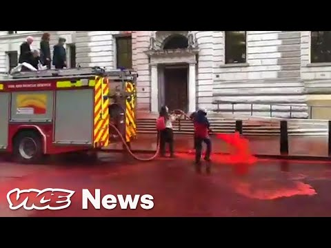 Climate Protestors Used A Fire Hose To Spray Fake Blood. It Didn't Go So Well.