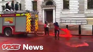 climate-protestors-used-a-fire-hose-to-spray-fake-blood-it-didn-t-go-so-well
