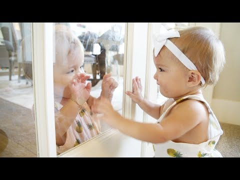 TWIN BABY GIRLS LAUGHING THROUGH THE GLASS (CUTE!)